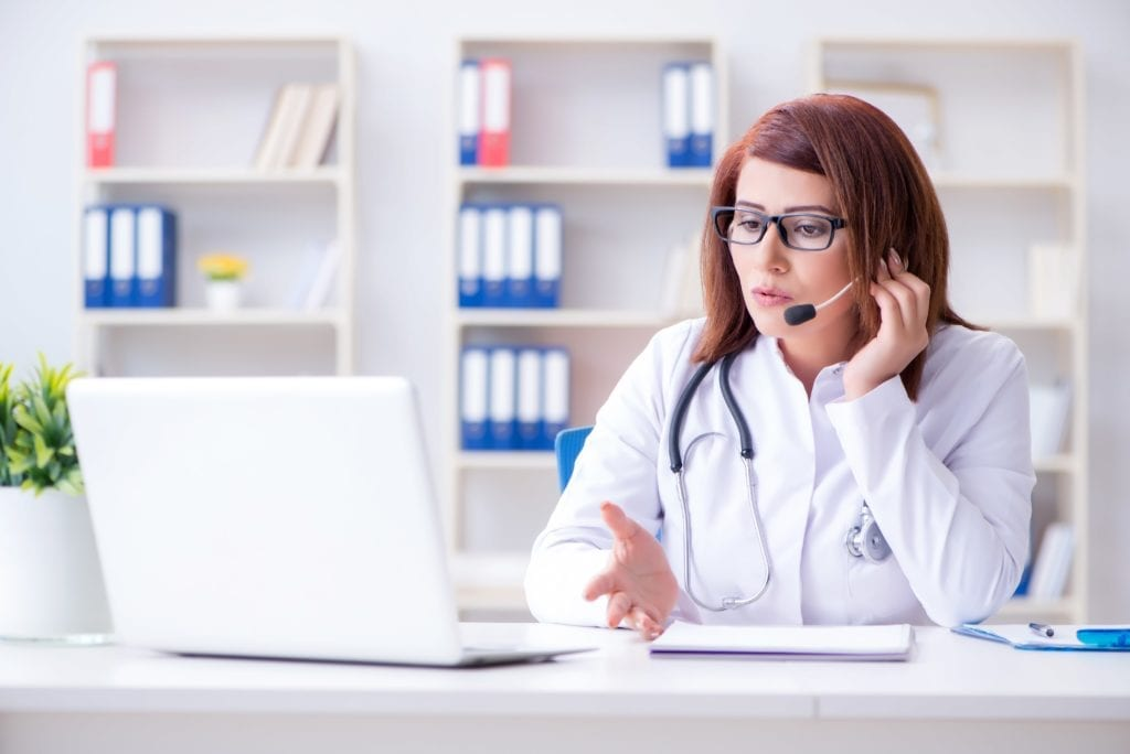 female doctor talking to patient via telehealth