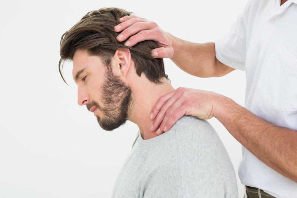 Man having chiropractic treatment performed on his neck