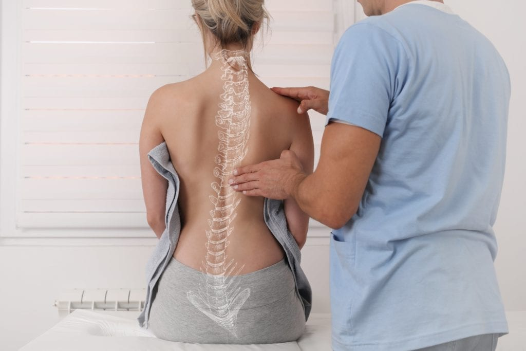woman with scoliosis being examined for chiropractic care